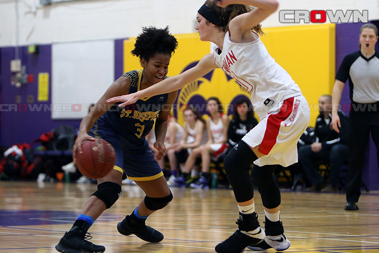 Micah Dennis (left) drives against Elle Cooney